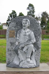 Statue of Henry Kendall, on an inclement day in Kendall, NSW